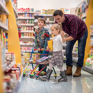 A man shopping with two young children